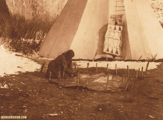 """Hide scraping"" - Apsaroke, by Edward S. Curtis from The North American Indian Volume 4"