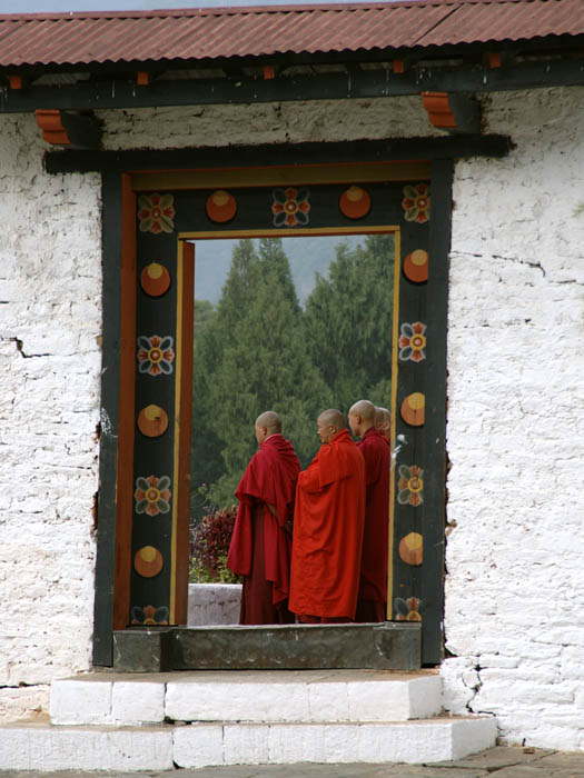 Buddhist monks in Bhutan in their maroon robes