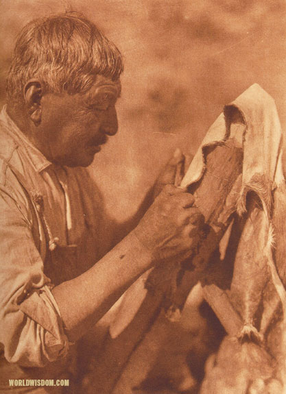 """Scraping a deerskin"" - Washo, by Edward S. Curtis from The North American Indian Volume 15"
