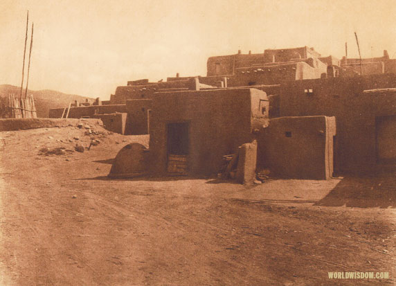 """A corner of Taos and a kiva entrance"" - Taos, by Edward S. Curtis from The North American Indian Volume 16"