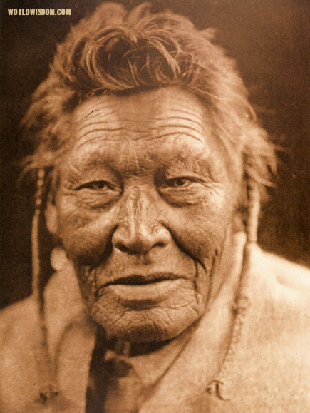 """Tsaaassi-mis-salla 'Crow with Necklace'"" - Sasri, by Edward S. Curtis from The North American Indian Volume 18"