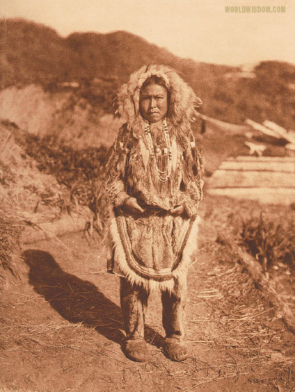 """Girl's costume"" - Nanivak, by Edward S. Curtis from The North American Indian Volume 20"