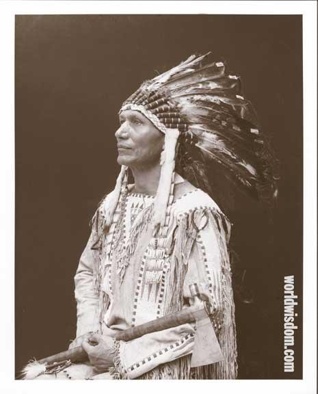 Charles Eastman (Ohiyesa of the Santee Sioux) in traditional clothing.